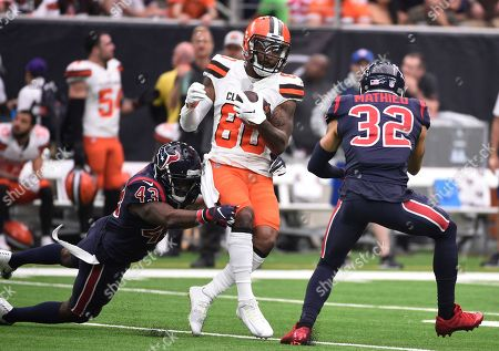 Jarvis Landry, Shareece Wright. Cleveland Browns wide receiver Jarvis Landry (80) is hit by Houston Texans defensive back Shareece Wright (43) after a catch during the first half of an NFL football game, in Houston