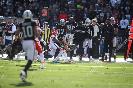 Oakland Raiders wide receiver Jordy Nelson (82) is tackled by Kansas City Chiefs cornerback Steven Nelson during the first half of an NFL football game in Oakland, Calif