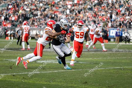 Oakland Raiders wide receiver Jordy Nelson, center, runs against Kansas City Chiefs defensive back Orlando Scandrick, left, and inside linebacker Reggie Ragland (59) during the second half of an NFL football game in Oakland, Calif