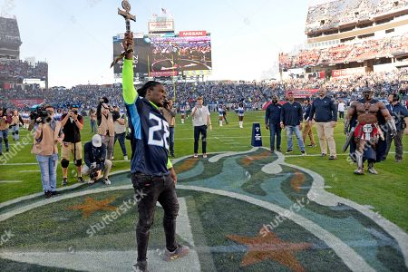 Former Tennessee Titans running back Chris Johnson serves as the team's 12th Man before an NFL football game between the Titans and the New York Jets, in Nashville, Tenn