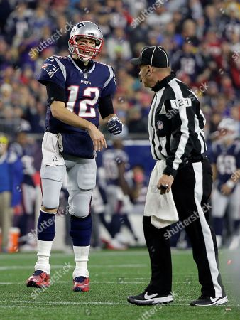 New England Patriots quarterback Tom Brady, left, appeals to umpire Paul King during the first half of an NFL football game against the Minnesota Vikings, in Foxborough, Mass