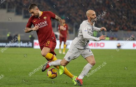 Roma's Aleksandar Kolarov, left, challenges for the ball with Inter Milan's Borja Valero during the Serie A soccer match between Roma and Inter Milan at the Rome Olympic stadium