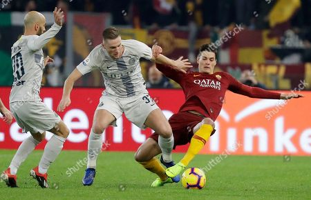 Roma's Patrik Shick, right, challenges for the ball with Inter Milan's Milan Skriniar, center, and Inter Milan's Borja Valero during the Serie A soccer match between Roma and Inter Milan at the Rome Olympic stadium