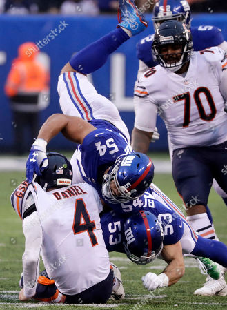 New York Giants linebackers Olivier Vernon (Top) and teammate New York Giants inside linebacker Connor Barwin (R) tackle Chicago Bears quarterback Chase Daniel (L) in the second half during the NFL American Football game between the Chicago Bears and the New York Giants at MetLife Stadium in East Rutherford, New Jersey, USA, 02 December 2018.
