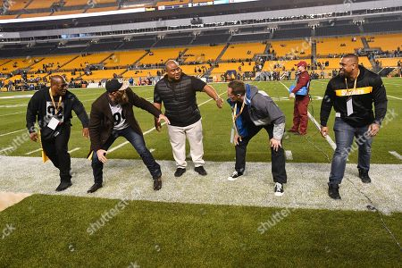 Stock Photo of Defensive team members from the Pittsburgh Steelers Super Bowl XLIII championship, left to right, linebacker James Harrison, defensive lineman Brett Kiesel, nose tackle Casey Hampton, defensive lineman Aaron Neil and linebacker Lamarr Woodley get to gether on the sideline before an NFL football game against the Los Angeles Chargers, in Pittsburgh