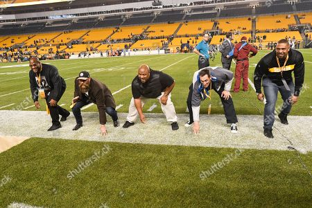 Defensive team members from the Pittsburgh Steelers Super Bowl XLIII championship, left to right, linebacker James Harrison, defensive lineman Brett Kiesel, nose tackle Casey Hampton, defensive lineman Aaron Neil and linebacker Lamarr Woodley get to gether on the sideline before an NFL football game against the Los Angeles Chargers, in Pittsburgh