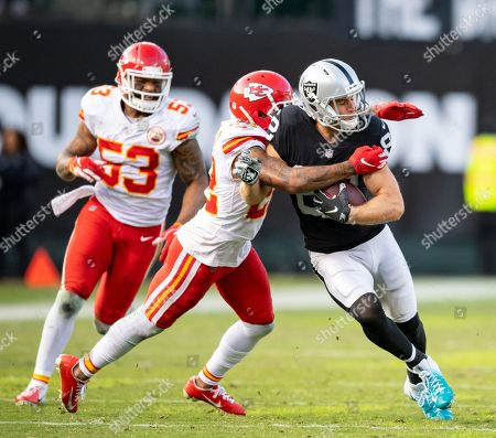 Oakland Raiders wide receiver Jordy Nelson (82) tries to break away from Kansas City Chiefs defensive back Orlando Scandrick (22), during a NFL game between the Kansas City Chiefs and the Oakland Raiders at the Oakland Coliseum in Oakland, California