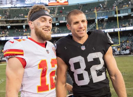 Kansas City Chiefs wide receiver Gehrig Dieter (12) and Oakland Raiders wide receiver Jordy Nelson (82) connect after a NFL game between the Kansas City Chiefs and the Oakland Raiders at the Oakland Coliseum in Oakland, California. The Chiefs won 40-33