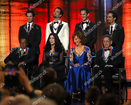 "Wayne Shorter, Cher, Reba McEntire, Philip Glass, Thomas Kail, Lin-Manuel Miranda, Andy Blankenbuehler, Alex Lacamoire. 2018 Kennedy Center honorees, front row from left, Wayne Shorter, Cher, Reba McEntire and Philip Glass; while back row from left, the co-creators of ""Hamilton,"" Thomas Kail, Lin-Manuel Miranda, Andy Blankenbuehler and Alex Lacamoire appear on stage during the 41st Annual Kennedy Center Honors at The Kennedy Center, in Washington"