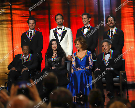 "Stock Picture of Wayne Shorter, Cher, Reba McEntire, Philip Glass, Thomas Kail, Lin-Manuel Miranda, Andy Blankenbuehler, Alex Lacamoire. 2018 Kennedy Center honorees, front row from left, Wayne Shorter, Cher, Reba McEntire and Philip Glass; and back row from left, the co-creators of ""Hamilton,"" Thomas Kail, Lin-Manuel Miranda, Andy Blankenbuehler and Alex Lacamoire appear on stage during the 41st Annual Kennedy Center Honors at The Kennedy Center, in Washington"
