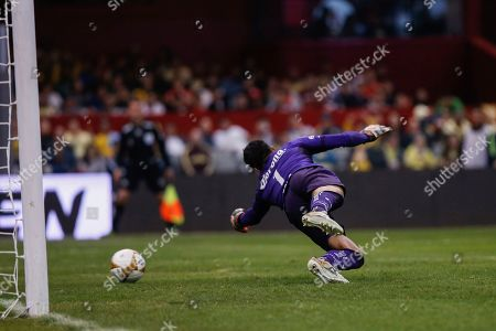 Toluca's Alfredo Talavera fails to stop a goal by America during a Mexico soccer league match in Mexico City, . America defeated Toluca 3-2