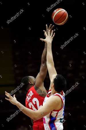 Javier Carter (L) of Panama in action against Jorge Diaz (R) of Puerto Rico during the FIBA 2019 China Basketball Word Cup Group E qualifying match between Panama and Puerto Rico at the Roberto Duran Arena, in Panama City, Panama, 02 December 2018.