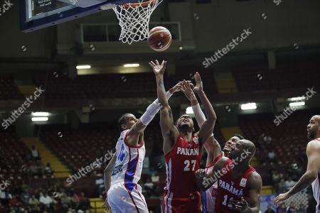 Daniel Giron (C) of Panama in action against  Gian Clavel (L) of Puerto Rico during the FIBA 2019 China Basketball Word Cup Group E qualifying match between Panama and Puerto Rico at the Roberto Duran Arena, in Panama City, Panama, 02 December 2018.