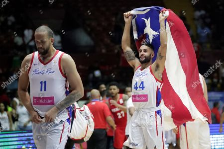 Javier Mojica (R) of Puerto Rico celebrates his team's victory at the end of the FIBA 2019 China Basketball Word Cup Group E qualifying match between Panama and Puerto Rico at the Roberto Duran Arena, in Panama City, Panama, 02 December 2018.