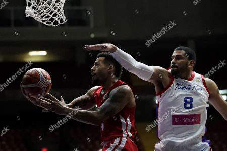 Trevor Gaskins (L) of Panama in action against  Angel Vasallo (R) of Puerto Rico during the FIBA 2019 China Basketball Word Cup Group E qualifying match between Panama and Puerto Rico at the Roberto Duran Arena, in Panama City, Panama, 02 December 2018.