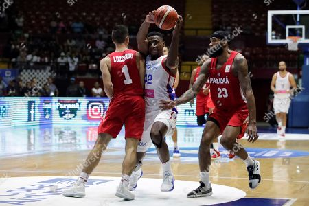 Eugenio Luzcando (L) of Panama in action against Alexander Franklin (C) of Puerto Rico during the FIBA 2019 China Basketball Word Cup Group E qualifying match between Panama and Puerto Rico at the Roberto Duran Arena, in Panama City, Panama, 02 December 2018.