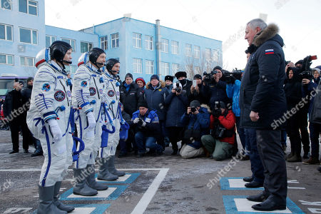 U.S. astronaut Anne McClain, left, Russian cosmonaut ?leg Kononenko?, centre, and CSA astronaut David Saint Jacques, members of the main crew of the expedition to the International Space Station (ISS), report to head or Russian space agency Dmitry Rogozin prior to the launch of Soyuz MS-11 space ship at the Russian leased Baikonur cosmodrome, Kazakhstan