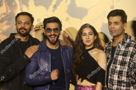 Ranveer Singh, Sara Ali Khan, Rohit Shetty, Karan Johar. From left, director Rohit Shetty, Bollywood actors Ranveer Singh, Sara Ali Khan, and producer Karan Johar pose during the trailer launch of their upcoming film Simmba in Mumbai, India