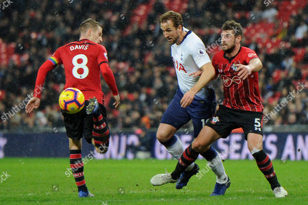 Harry Kane (C)  of Tottenham Hotspur and Steven Davies (L) and Jack Stephens (R) of Southampton in action during the Premier League match between Tottenham Hotspur and Southampton at Wembley Stadium in London, UK - 5th December 2018
