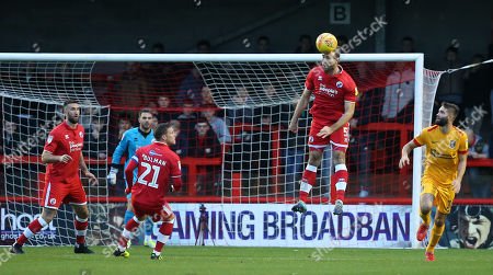 Joe McNerney of Crawley heads clear during the EFL League Two match between Crawley Town and Northampton Town at the Broadfield Stadium in Crawley. 8 December 2018