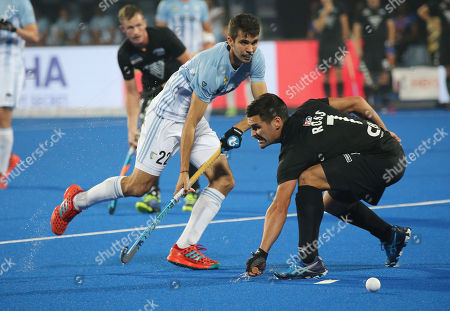 Stock Image of Argentina?s Matias Rey (L) in action against  Nick Ross of New Zealand during the men's Field Hockey World Cup match between New Zealand and  Argentina at the Kalinga Stadium in Bhubaneswar, India, 03 December 2018.