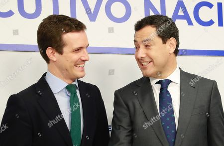 People's Party (PP) leader, Pablo Casado (L), greets PP's candidate for the Andalusian Presidency, Juanma Moreno (R), at the start of the party's national executive committee held to analyse the results of the elections in Andalusia, in Madrid, Spain, 03 December 2018. PP's candidate Juanma Moreno came second with 26 seats, behind the winning Socialist Party (PSOE), that suffered a 14 seats loss in comparison with the 2015 regional vote. The results show an approach to the conservative side after Ciudadanos won 21 seats and right-wing Vox party obtained 12 seats. With this political map Vox has became the key to form Government and oust the acting Andalusian President Susana Diaz (PSOE) in a region that has been ruled by the PSOE for the last 36 years.