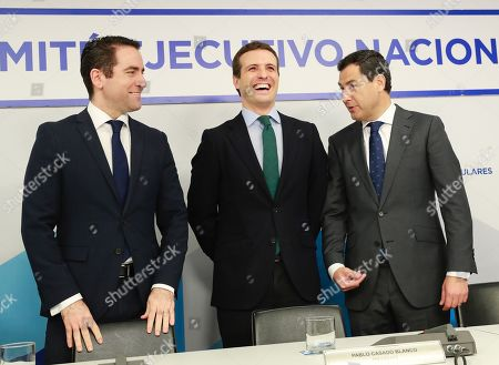 People's Party (PP) leader, Pablo Casado (C), smiles next to PP's candidate for the Andalusian Presidency, Juanma Moreno (R), and the secretary-general of PP, Teodoro Garcia Egea, at the start of the party's national executive committee held to analyse the results of the elections in Andalusia, in Madrid, Spain, 03 December 2018. PP's candidate Juanma Moreno came second with 26 seats, behind the winning Socialist Party (PSOE), that suffered a 14 seats loss in comparison with the 2015 regional vote. The results show an approach to the conservative side after Ciudadanos won 21 seats and right-wing Vox party obtained 12 seats. With this political map Vox has became the key to form Government and oust the acting Andalusian President Susana Diaz (PSOE) in a region that has been ruled by the PSOE for the last 36 years.