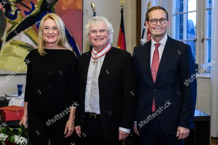 British conductor Sir Simon Rattle (C), his wife Magdalena Kozena (L) and Berlin Governing Mayor Michael Mueller pose for photographers after a hand over of the Order of Merit of the State of Berlin, in Berlin, Germany, 03 December 2018. Rattle, who became the conductor of the Berlin Philharmonics in 2002, moves on to London and takes over the London Symphony Orchestra.