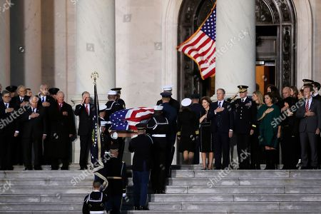 George W Bush, Dick Cheney, Colin Powell, James Baker, Dan Quayle. The flag-draped casket of former President George H.W. Bush is carried by a joint services military honor guard in front of his family led by his son former President George W. Bush, right, Vice President Dick Cheney, from left, former Secretary of State Colin Powell, former Secretary of State James Baker and his Vice President Dan Quayle, to the U.S. Capitol in Washington