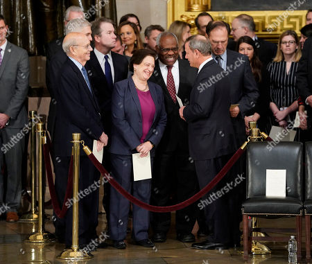Brett Kavanaugh, Elena Kagan, Clarence Thomas, John Roberts, Neil Gorsuch, Stephen Breyer, Clarence Thomas. Supreme court Chief Justice John Roberts, second from the right, talks with from l-r., Associate Justices, Stephen Breyer, Neil Gorsuch, Brett Kavanaugh, Elena Kagan, Clarence Thomas, and Samuel Alito, after arriving for services for former President George H.W. Bush at the U.S. Capitol in Washington