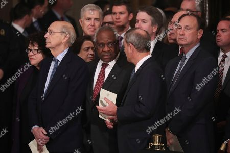 Justices of the U.S. Supreme Court including, from left Associate Justices Judge Sonia Sotomayor, Stephen Breyer, Elena Kagan, Neil Gorsuch, Clarence Thomas, Chief Justice John Roberts, Associate Justice Brett Kavanaugh, former Associate Justice Anthony Kennedy and Associate Justice Samuel Alito await the arrival of the casket of former U.S. President George H.W. Bush inside the U.S. Capitol Rotunda, where it will lie in state in Washington