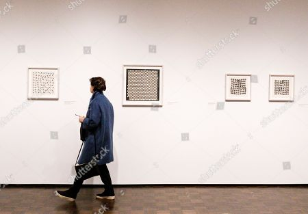 A person looks at works gathered for the exhibit 'Julio Le Parc 1959' at the Met Breuer Museum in New York, New York, USA, 03 December 2018. The exhibit, which opens on 04 December 2018 and runs until 24 February 2019, is the Argentinian artist's first solo show in New York.