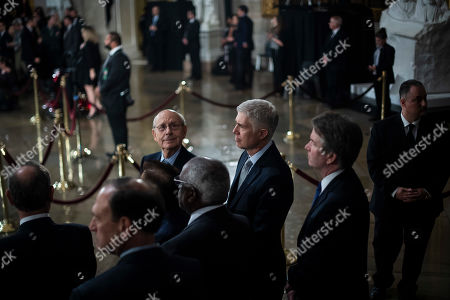 Stock Picture of Supreme Court Associate Justice Stephen Breyer, Associate Justice Neil M. Gorsuch, and Associate Justice Brett M. Kavanaugh wait for the arrival of Former president George H.W. Bush to lie in State at the U.S. Capitol Rotunda on Capitol Hill  in Washington, DC, USA, 03 December 2018. Bush will lie in state in the Capitol Rotunda before his state funeral at the Washington National Cathedral 05 December. George H.W. Bush, the 41st President of the United States (1989-1993), died at the age of 94 on 30 November 2018 at his home in Texas.