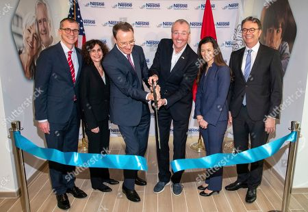 From left to right, Greg Behar, CEO, Nestlé Health Science S.A., Anna Mohl, BEO, Nestlé Health Science U.S., Mark Schneider, CEO, Nestlé S.A., Phil Murphy, Governor of New Jersey, Susan Haid, Head of Nestlé Product Technology Center, Nestlé Health Science and Thomas Hauser, SVP, Head of Global Product & Technology Development, Nestlé S.A. cut the ribbon at the inauguration of Nestlé Health Science's Product Technology Center on in Bridgewater, N.J