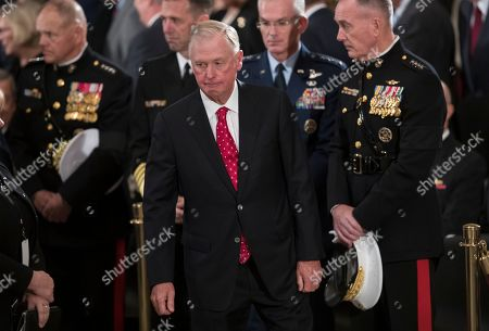 Former Vice President Dan Quayle walks past the flag-draped casket of former President George H.W. Bush in the Capitol Rotunda in Washington