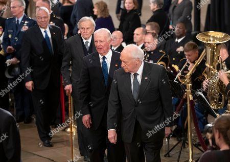 Dick Cheney, James Baker, Nicholas Brady, Colin Powell. From front to back, members of George HW Bush's Cabinet, former Defense Secretary Dick Cheney, former Secretary of State James Baker III, former Treasury Secretary Nicholas Brady, and Gen. Colin Powell, who served as chairman of the Joint Chiefs of Staff, walk past the flag-draped casket of the 41st president in the Capitol Rotunda in Washington