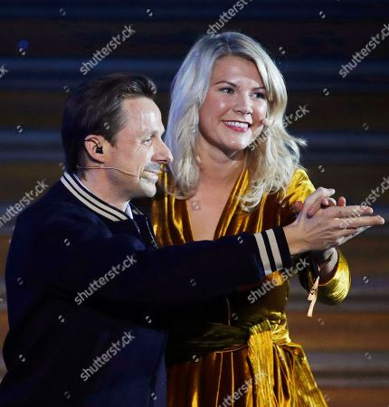 Olympique Lyonnais' Ada Hegerberg (R) dances with French DJ Martin Solveig (L) after being awarded with the 'Ballon d'Or' (Golden ball) during a ceremony rewarding the best European Footballer of the Year in Paris, France, 03 December 2018 (issued on 04 December 2018). Host Solveig apologised to Hegerberg for asking her after collecting her award if she knew 'how to twerk' on stage.