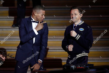"""Paris St Germain's Kylian Mbappe, left, celebrates with DJ Martin Solveig after receiving the Kopa Trophy during the Golden Ball, """"Ballon d'Or"""" award ceremony at the Grand Palais in Paris, France, Monday, Dec.3, 2018. Awarded every year by France Football magazine since Stanley Matthews won it in 1956, the Ballon d'Or, Golden Ball for the best player of the year will be given to both a woman and a man"""