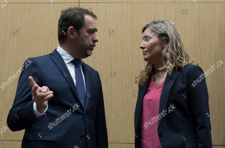 French Interior Minister Christophe Castaner (L) speaks with parliamentary committee president Yael Braun-Pivet (R) as he arrives for a parliamentary hearing to investigate the police handling of the 'Yellow Vests' protest two days earlier, next to the Champs Elysee in Paris, France, 03 December 2018. The so-called 'gilets jaunes' (yellow vests) held a protest on the Champs-Elysees on 01 December, which descended into scenes of rioting, arson and looting, and widespread violence across the city. The movement  reportedly has no political affiliation, is running into its third week across the nation, over high fuel prices.