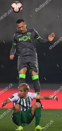 Stock Photo of Rio Ave FC's Fabio Coentrao (L) in action against Sporting CP's Jefferson (R) during their Portuguese First League soccer match, held at Arcos stadium, Vila do Conde, Porto, Portugal, 03 December 2018.