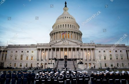Stock Photo of The casket carrying former president George Herbert Walker Bush is carried up the steps of the US Capitol in Washington, DC, USA, 03 December 2018. Bush will lie in state in the Capitol Rotunda before his state funeral at the Washington National Cathedral 05 December. George H.W. Bush, the 41st President of the United States (1989-1993), died at the age of 94 on 30 November 2018 at his home in Texas.