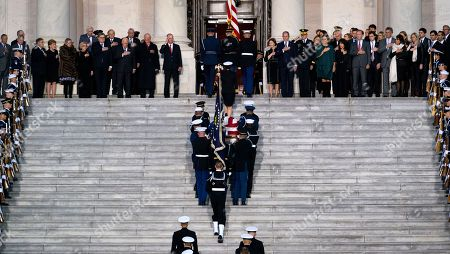 Stock Image of The casket carrying former president George Herbert Walker Bush is carried up the steps of the US Capitol in Washington, DC, USA, 03 December 2018. Bush will lie in state in the Capitol Rotunda before his state funeral at the Washington National Cathedral 05 December. George H.W. Bush, the 41st President of the United States (1989-1993), died at the age of 94 on 30 November 2018 at his home in Texas.