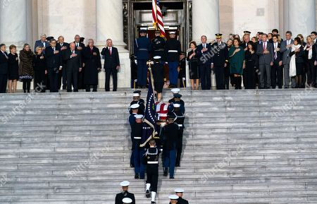 The casket carrying former president George Herbert Walker Bush is carried up the steps of the US Capitol in Washington, DC, USA, 03 December 2018. Bush will lie in state in the Capitol Rotunda before his state funeral at the Washington National Cathedral 05 December. George H.W. Bush, the 41st President of the United States (1989-1993), died at the age of 94 on 30 November 2018 at his home in Texas.