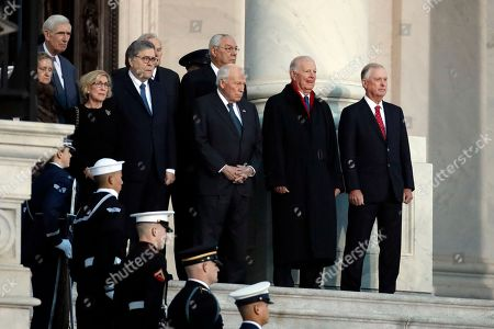 From right, former US Vice President Dan Quayle, James A. Baker III, former Vice President Dick Cheney, former Secretary of State Colin Powell and other wait for the flag-draped casket of former President George H.W. Bush to arrive to lie in state in the rotunda of the U.S. Capitol, in Washington, DC, USA, 03 December 2018. Bush will lie in state in the Capitol Rotunda before his state funeral at the Washington National Cathedral on 05 December. George H.W. Bush, the 41st President of the United States (1989-1993), died at the age of 94 on 30 November 2018 at his home in Texas.