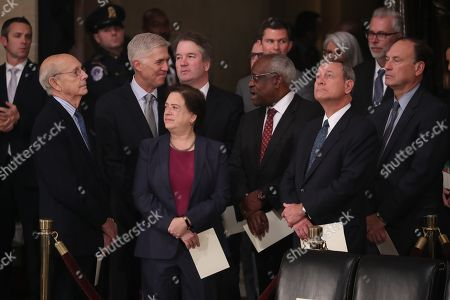 Stock Photo of Justices of the US Supreme Court including (L-R) Associate Justices Stephen Breyer, Neil Gorsuch, Elena Kagan, Brett Kavanaugh, Clarence Thomas, Chief Justice John Roberts and Associate Justice Samuel Alito await the arrival of the casket of former US President George H.W. Bush inside the US Capitol in Washington, DC, USA, 03 December 2018. Bush will lie in state in the Capitol Rotunda before his state funeral at the Washington National Cathedral 05 December. George H.W. Bush, the 41st President of the United States (1989-1993), died at the age of 94 on 30 November 2018 at his home in Texas.