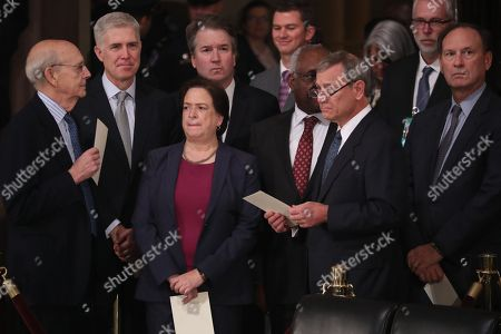 Stock Picture of Justices of the U.S. Supreme Court including (L-R) Associate Justices Stephen Breyer, Neil Gorsuch, Elena Kagan, Brett Kavanaugh, Clarence Thomas, Chief Justice John Roberts and Associate Justice Samuel Alito await the arrival of the casket of former U.S. President George H.W. Bush inside the U.S. Capitol Rotunda, where it will lie in state in Washington, DC, USA, 03 December 2018. Bush will lie in state in the Capitol Rotunda before his state funeral at the Washington National Cathedral 05 December. George H.W. Bush, the 41st President of the United States (1989-1993), died at the age of 94 on 30 November 2018 at his home in Texas.