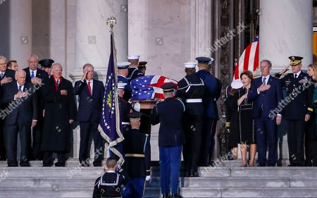 The casket of former United States President George H. W. Bush is carried by a color guard up the steps of the US Capitol as former Vice President Dick Cheney (L) General Ret. Colin Powell (2L) former Chief of Staff James Baker (3L) and former United States President George W. Bush (R) and former First Lady Laura Bush (2R) look on in Washington, DC, USA, 03 December 2018. Bush, the 41st President of the United States (1989-1993), died in his Houston, Texas, USA, home surrounded by family and friends on 30 November 2018. The body will Lie in State in the Capitol before being moved to the Washington National Cathedral for a funeral service. It will then return to Houston for another funeral service before being transported by train to the George Bush Presidential Library and Museum for internment.