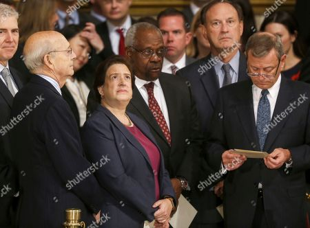 US Supreme Court Justices Neil M. Gorsuch (L), Elena Kagan (2L), Clarence Thomas (2R) and Chief Justice John G. Roberts, Jr.,(R) await the arrival of the casket bearing the body of former US President George H.W. Bush at the US Capitol in Washington, DC, USA, 03 December 2018. Bush, the 41st President of the United States (1989-1993), died in his Houston, Texas, USA, home surrounded by family and fiends on 03 November 2018. The body will Lie in State in the Capitol before being moved to the Washington National Cathedral for a funeral service. It will then return to Houston for another funeral service before being transported by train to the George Push Presidential Library and Museum for internment.