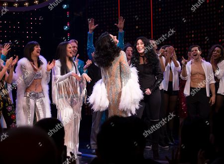 """Micaela Diamond, Teal Wicks, Stephanie J. Block, Cher. Cher on stage with cast members during the curtain call for """"The Cher Show"""" Broadway musical opening night at the Neil Simon Theatre, in New York"""