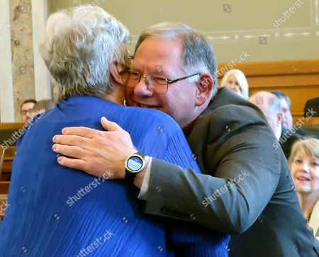 Kansas state Rep. Dan Hawkins, R-Wichita, right, gets a hug from Rep. Brenda Landwehr, also R-Wichita, left, after being chosen by Republicans as House majority leader, at the Statehouse in Topeka, Kan. Hawkins is a conservative and has unseated moderate Majority Leader Don Hineman, R-Dighton